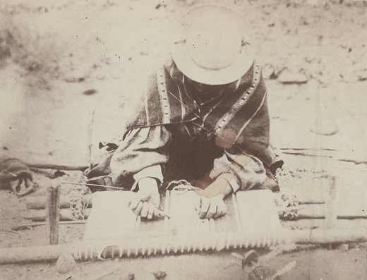 Argentine Woman in Costume, Weaving on Loom on Ground 1899 by W.E. Chandlee. Image courtesy of the National Anthropological Archives.