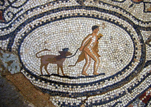 Ancient mosaic of a man and his dog