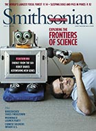 Javier Movellan with his kid-friendly robot RUBI, on the cover of the July issue