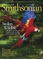 The scarlet macaw, on the cover of the December issue, is prized by smugglers