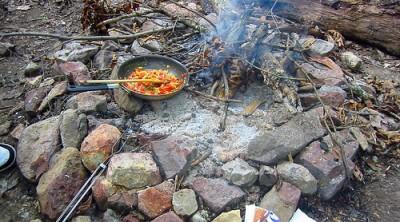 Cooking over a campfire, courtesy of Flickr user Rev. Xanatos