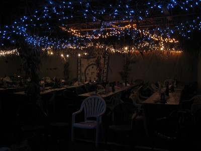 A sukkah at night, courtesy of Flickr user rbarenblat