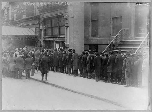 Men in bread line on 41st St., New York City in 1915 -- Courtesy of the Library of Congress