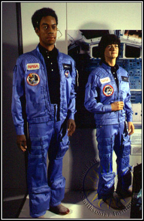 Sally Ride's in-flight suit, next to that of another pioneering astronaut, TK, the first African-American in space. Photo by Eric Long, courtesy of the Smithsonian National Air and Space Museum.