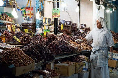A date keeper at a souk in Kuwait. Courtesy of Flickr user miskan