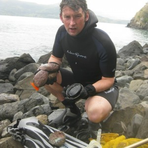 Andrew bland, brother of the author, shivers and shakes after a frigid abalone, or paua, dive in Akaroa Harbour.