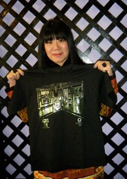 Fashion designer Anna Sui with her Peacock Room-inspired t-shirt. Photo courtesy of the Freer Gallery of Art.