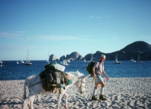 Graham Mackintosh and his burro Bonny arrive in Cabo San Lucas while trekking in the early 1980s, when the resort destination was still a quiet village.