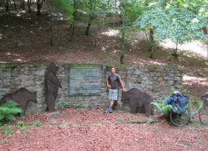 The author stands at a monument placed in the forest near the border of Spain at the site where three bears were released in 1995 and 1996. Photo by Alastair Bland