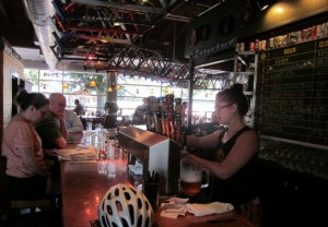 At Hopworks Urban Brewery, two of Portland's most popular themes meld---bicycles and beer. A line of retired bike frames hangs above the bar. Photo by Alastair Bland.