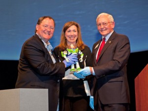 John Lasseter, chief creative officer at Pixar; Lori Garver, NASA deputy administrator; and Museum director Jack Dailey hold Buzz Lightyear, the Museum's newest acquisition. Photograph courtesy Mark Avino/NASM.
