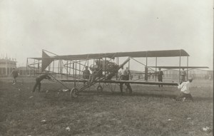 "Curtiss-Herring No. 1 ""Reims Racer"" on the ground at the Coupe Gordon Bennett race, August 28, 1909, Reims, France. Glenn Curtiss is at the controls. Image courtesy NASM."