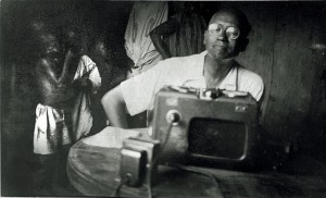 Lorenzo Dow Turner taping informants in Africa. Photo courtesy of the Lorenzo Dow Turner Papers, Anacostia Community Museum Archives, Smithsonian Institution.