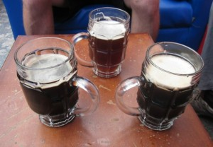 Craft beer is hard to come by in much of Ecuador, but these handsome beers--two stouts and a Belgian-style dubbel--can be enjoyed near Quito's thriving Foch Plaza. Photo by Alastair Bland.