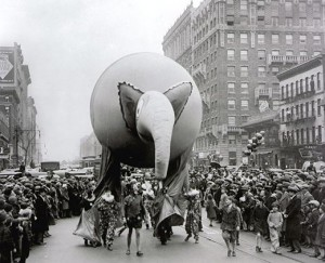 A giant elephant balloon makes its way down a New York City street at the Macy's Christmas Parade in 1927.