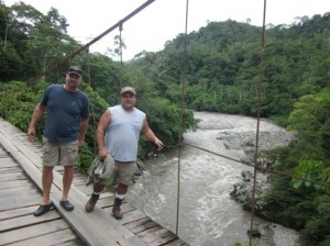 Curt McGary, left, and Paul Salazar stand on a suspension bridge over the Rio Negro in the Ecuadorian Amazon basin. Along the river's banks, gold lurks in the sediments, and the Americans planned to extract it.