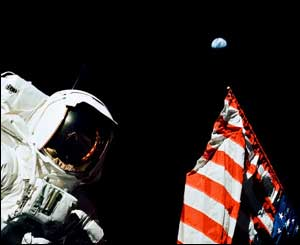 "Harrison ""Jack"" Schmitt on the moon, December 1972, with Earth in the background."