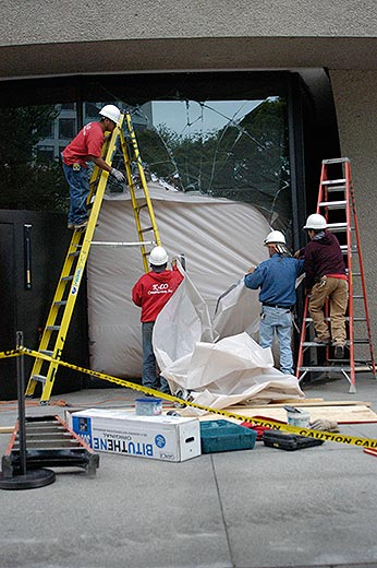 Workers are already busy repairing the broken glass window. Photo credit to Ryan Reed