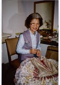 May Ishimoto sews a costume backstage in this undated family photo. Courtesy of Mary Ishimoto Morris.