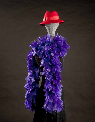 The Red Hat Society donates its founder's original red hat and a purple boa to the National Museum of American History. Photo courtesy of NMAH.