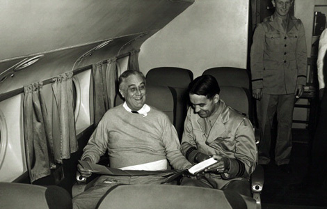 Photo from the FDR library, showing President Roosevelt in a happy conversation with the TWA pilot of the Boeing 314, Otis Bryan.