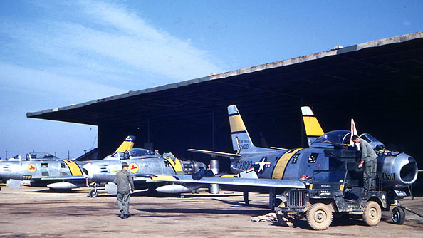 Maintaining F-86 Sabre jets in Korea, circa 1952-1954. (Photo by Richard Rash, SI 97-1357)