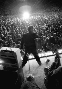 A 21-year-old Elvis sings to a crowd of thousands. Photo by Albert Wertheimer.