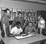 Gene Shoemaker (standing, second from right) of the U.S. Geological Survey led the Surveyor TV experiment team.