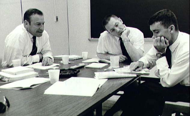 """It says, 'Subtract the amount on line 39, Form 1040, from...' "" (L-R) Lovell, Swigert, Haise review data on the first day of their post-flight debriefing at the Manned Spacecraft Center in Houston, April 20, 1970. Photo: NASA"