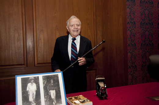 Navy Lt. Cmdr. Ted Robinson, 91, holds the cane he is donating to the National Museum of American History. The cane was used by President John F. Kennedy during World War II. Photo Courtesy of the National Museum of American History