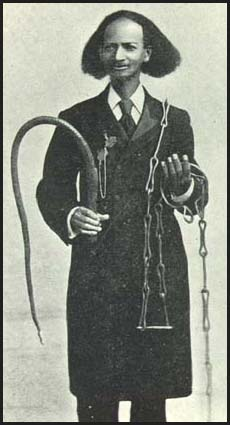 Thomas Johnson–born into slavery in the United States in 1836, emancipated in the wake of the Civil War, and author of Twenty-Eight Years a Slave (1909)–displays some of the whips, shackles and restraints used to control and discipline salves both in the US and the Caribbean.