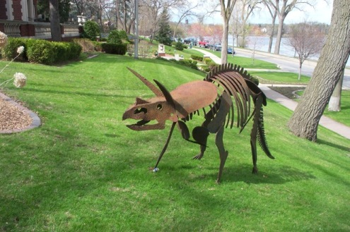 A metallic Triceratops, photographed on the grounds of a Minneapolis, MN mansion. Photo by Mark Ryan.