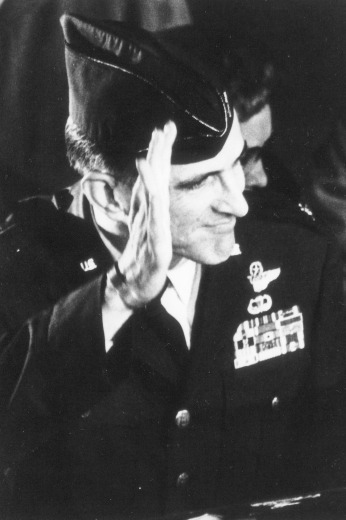 With his mangled hand, Lt. Col. Johnson salutes friends and family upon his homecoming at Sheppard Air Force Base, Texas, February 17, 1973. Photo courtesy of the Office of Congressman Sam Johnson.
