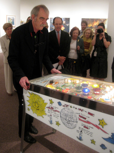 William Wiley regales members of the press with his pinball skills. Photo by Abby Callard.