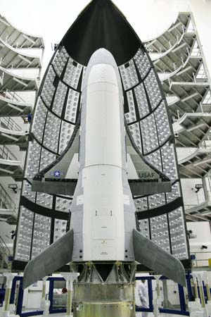 The X-37 Orbital Test Vehicle is outlined by its payload fairing in the Astrotech facility in Titusville, Florida, April 2010. Photo: U.S. Air Force