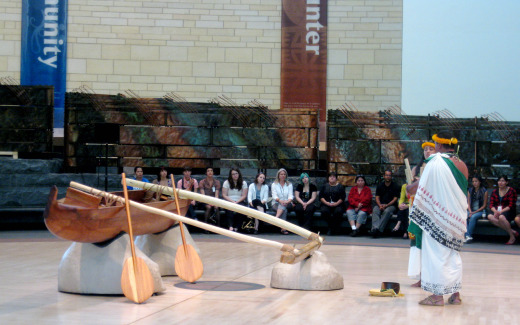John Kapono'ai Molitau blesses the traditional Hawaiian Canoe at the National Museum of the American Indian to commemorate the 5th anniversary and recognize the repairs done by the Friends of Hokule'a and Hawai'iloa, who donate the canoe when the museum first opened. Photo by Abby Callard.