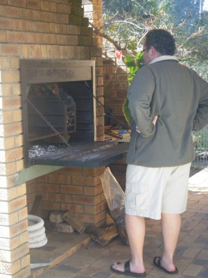 Manning the braai, a traditional South African barbecue, at a home in Cape Town.