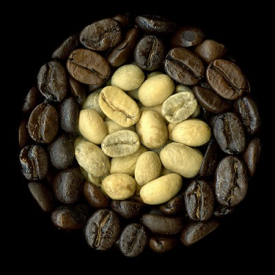 Coffee beans, roasted and unroasted (center), courtesy Flickr user cgfan