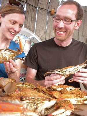 Amanda gets a crash course in crab eating from Baltimore native Steve.