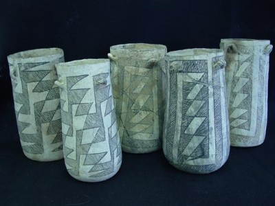 The cylinder jars which had traces of chocolate, before they were broken