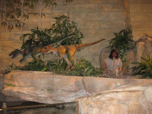Dinosaurs and humans are shown living together in the Creation Museum in Kentucky. From Flickr user yumiec00kies.