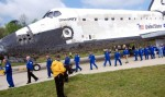 Discovery rolled into view with a parade of its former astronaut commanders.