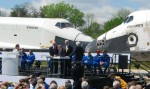NASA and Smithsonian officials sign the document that transfers Discovery to the National Air and Space Museum.