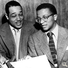 Billy Strayhorn demonstrating a passage to Duke Ellington. Frank Driggs Collection