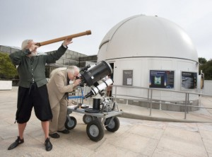 Galileo impersonator Mike Francis and curator David DeVorkin look at the skies through their respective telescopes. Photo by Eric Long.