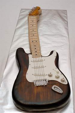Edible guitar cake, courtesy of Flickr user Omar de Armas