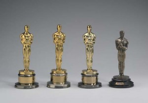 Katharine Hepburns four Academy Awards are currently being shown in the National Portrait Gallery. Her first Oscar, on the right, is the original design made of a gold-plated bronze.