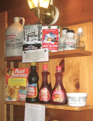 Real maple syrup containers, top shelf, and imposters, below. Photograph by Lisa Bramen