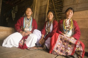 Three Koro speakers at a house in Kichang village in Arunachal Pradesh, India(Photo by Chris Rainier)