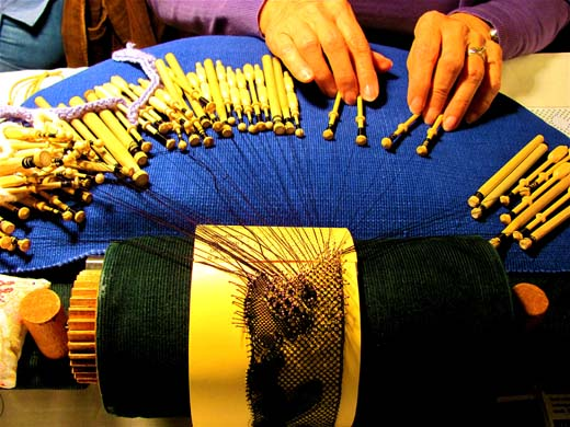 The lace maker's bobbins are used to weave the thin strands of thread into lace. Photo by Audrey Reinhardt
